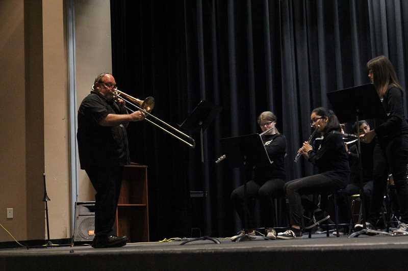 PMG PHOTO: JUSTIN MUCH - Woodburn's longtime band teacher Brian Gingrich chips in with the trombone during the schools Spring Band Concert.