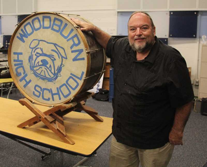 PMG PHOTO: JUSTIN MUCH - Woodburn's longtime band teacher Brian Gingrich will retires this year after 35 years with the district, leaving a legacy so solid that part of it, his former student and current Washington Elementary School music teacher, Nadia Maksimov, will succeed him.
