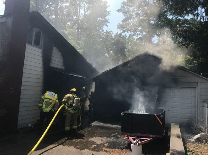 COURTESY PHOTO: SCAPPOOSE FIRE DISTRICT - Scappoose Fire District crews were able to put out a garage fire on Southwest Maple Street in Scappoose before it spread to the house last week. FIre officials determined the fire was caused by hot embers in a container near the garage. Now, they are using the incident to remind residents to store ashes in metal conatiners away from buildings while the ashes cool.