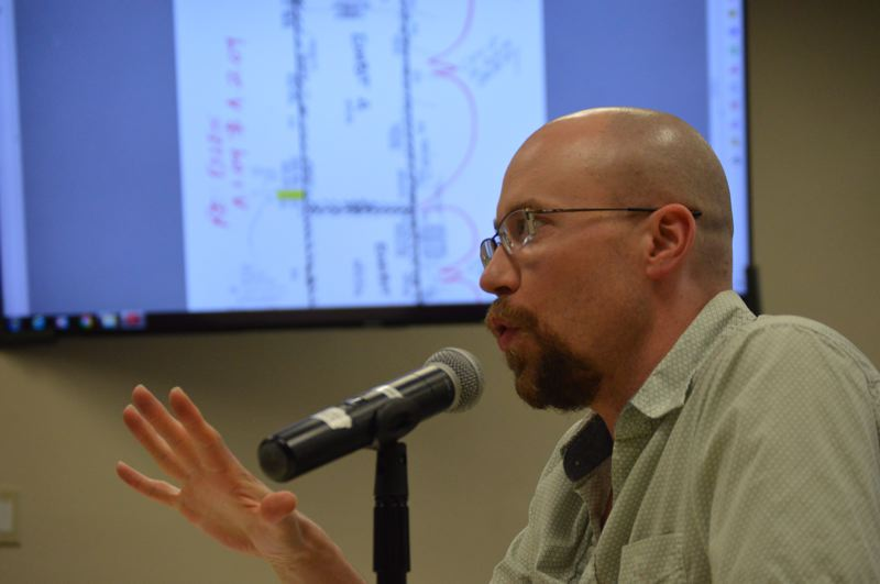 PMG PHOTO: NICOLE THILL-PACHECO - St. Helens City Planner Jacob Graichen speaks with the St. Helens City Council on Wednesday, June 5, with a reference map of the citys property on Millard Road. The city recently approved a contract to develop a park design plan for a portion of the land.