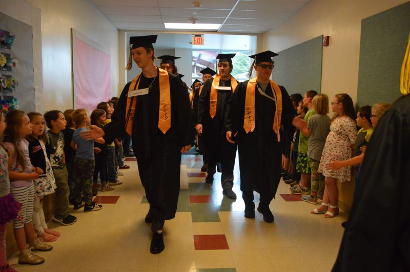 PMG PHOTOS: NICOLE THILL-PACHECO - St. Helens High School seniors walk through the hallways of Lewis and Clark Elementary School on Wednesday, June 5.