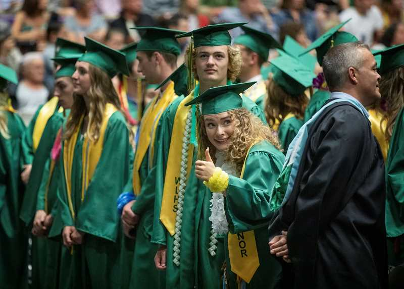 PMG PHOTO: JONATHAN HOUSE - Parker Martin gives a thumbs up during West Linn High School's graduation June 4.