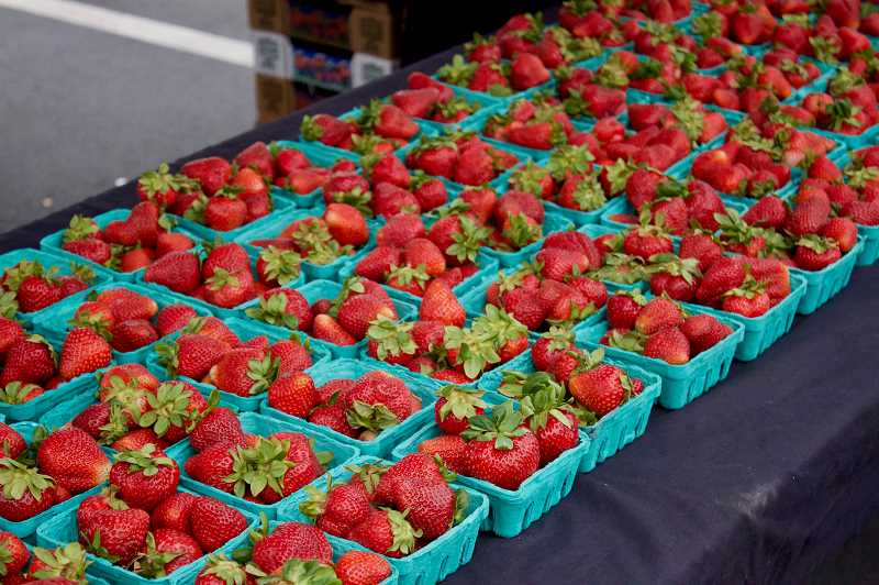 PMG PHOTO: CHRISTOPHER KEIZUR - There were plenty of offerings at the Twilight Market, including berries and other produce.