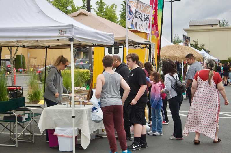 PMG PHOTO: CHRISTOPHER KEIZUR - The new Gresham Station Twilight Market brings an evening farmers market to the community.