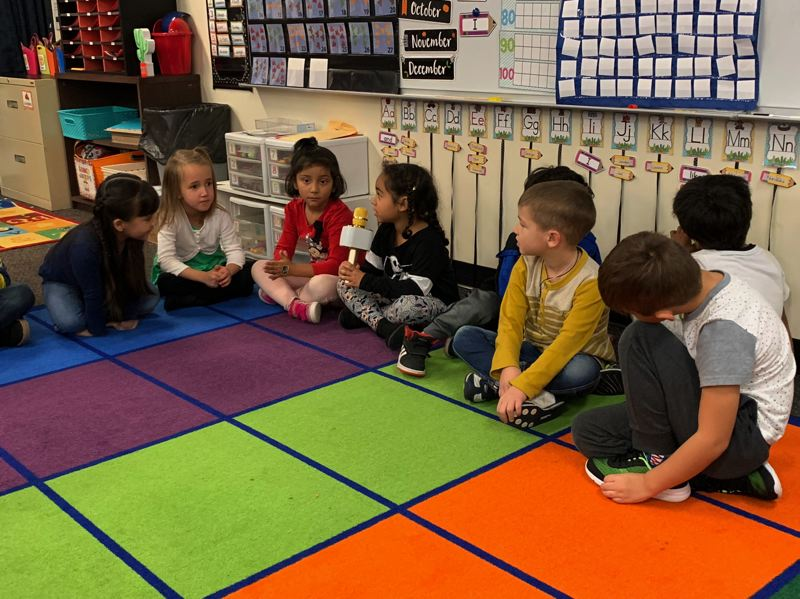 COURTESY PHOTO: GRESHAM-BARLOW SCHOOL DISTRICT - Some of Highland Elmentary Schools youngest scholars have a discussion. The district has worked to reduce class sizes in kindergarten and first grade and plans to use the new money to cut class sizes in all grades.