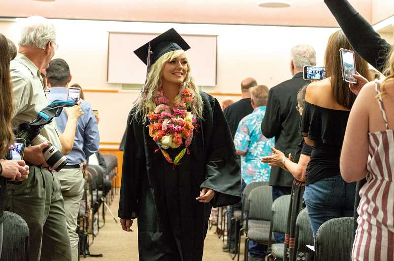 PMG PHOTO: CLARA HOWELL  - Cydney Williams gets ready to receive her diploma during graduation.