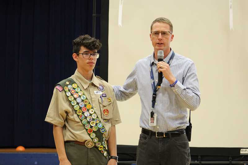 PMG PHOTO: KRISTEN WOHLERS - Ninety-One School Principal Skyler Rodolph introduces former student and soon-to-be Eagle Scout Kaleb Ferriss.