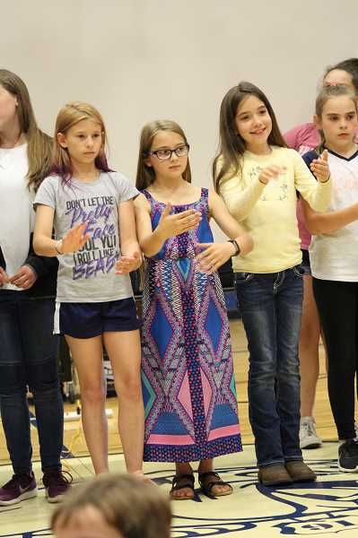 PMG PHOTO: KRISTEN WOHLERS - Ninety-One School students perform sign language while the choir sings.