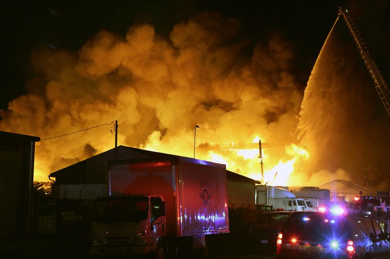 COURTESY PHOTO: DAVID ASHTON - A three-alarm fire destroyed an auto parts building on Southeast Long Street Friday, June 7.