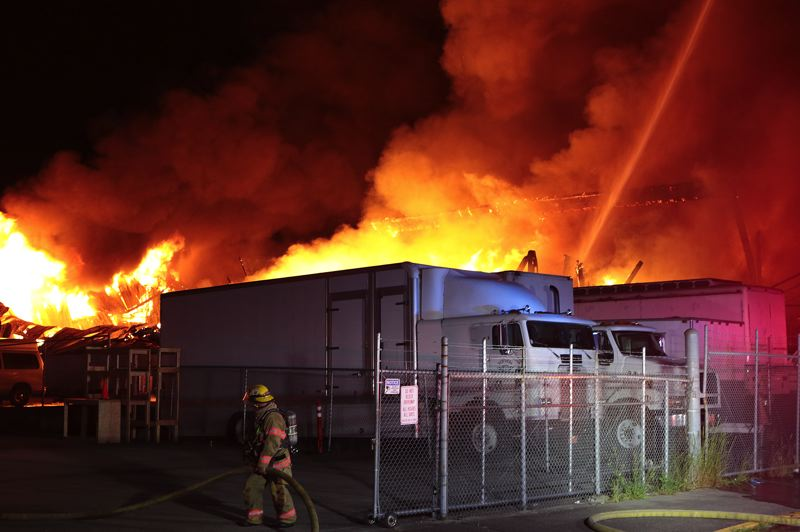 COURTESY PHOTO: DAVID ASHTON - Portland fire investigators are looking for the cause of a Friday night blaze that destroyed the RJ Templeton Co. auto parts warehouse in the 2700 block of Southeast Long Street. The June 7 blaze damaged nearby houses and vehicles.