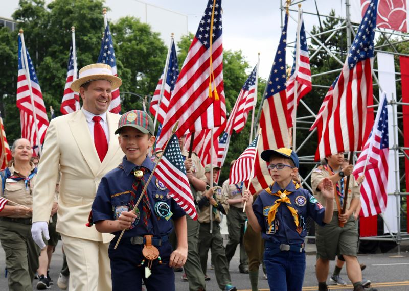 PMG PHOTO: ZANE SPARLING - Local Boy Scouts tromped along during the 2019 Grand Floral Parade in Portland on Saturday, June 8.