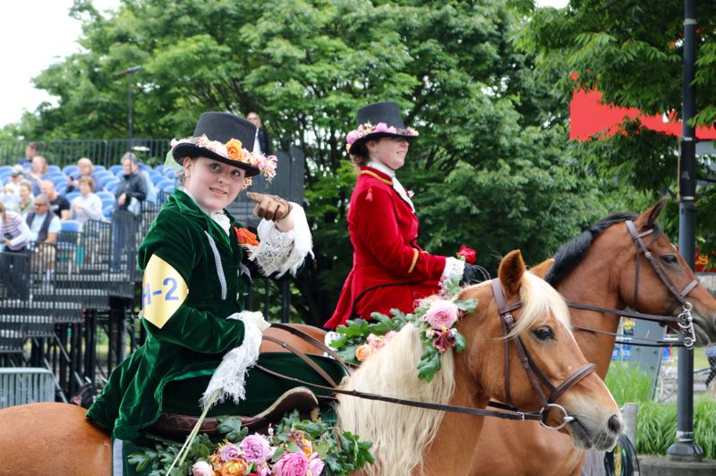 PMG PHOTO: ZANE SPARLING - A mounted rider greats the crowd during the 2019 Grand Floral Parade on Saturday, June 8 in Portland.