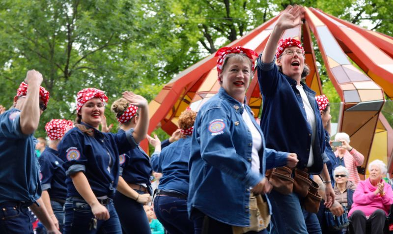 PMG PHOTO: ZANE SPARLING - Women dressed like Rosie the Riveter march toward downtown Portland during the 2019 Grand Floral Parade on Saturday, June 8.