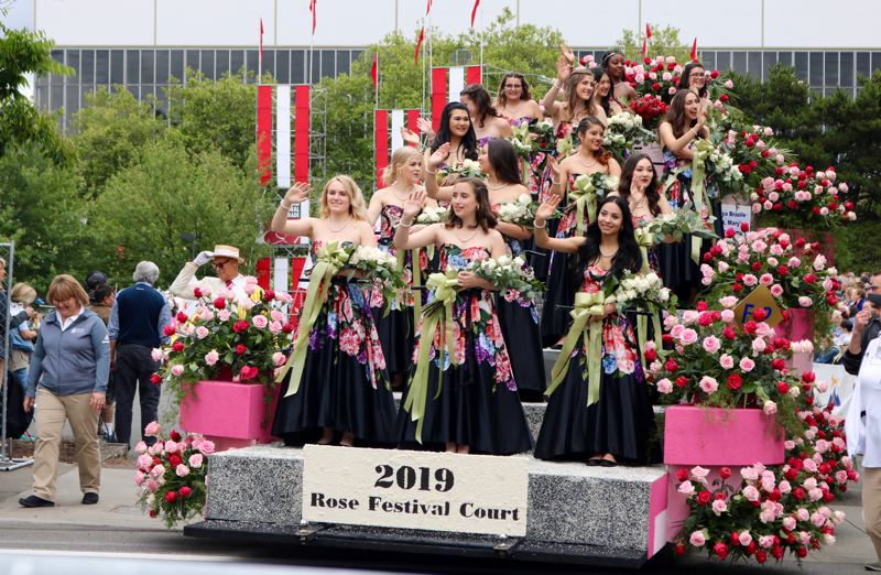 PMG PHOTO: ZANE SPARLING - The other 15 members of the 2019 Rose Festival Court wave to the crowd of Portlanders on Saturday, June 8.