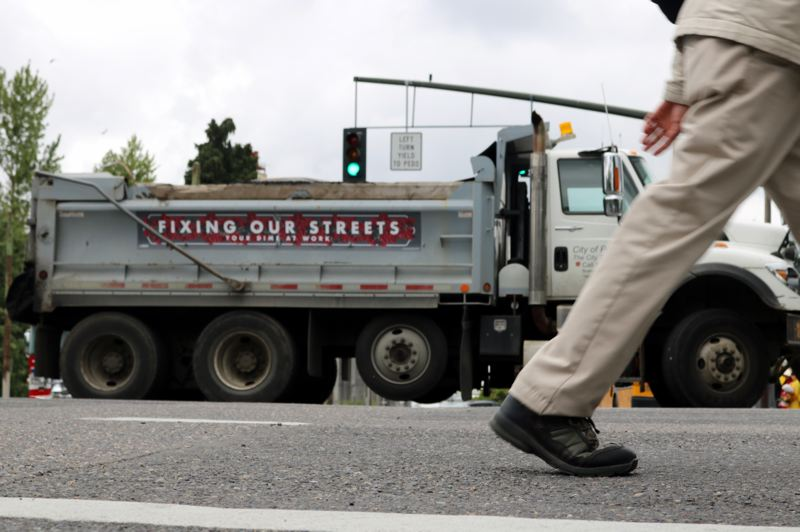 PMG PHOTO: ZANE SPARLING - Another PBOT dump truck was blocking traffic along the route of the Grand Floral Parade in Portland on Saturday, June 8.