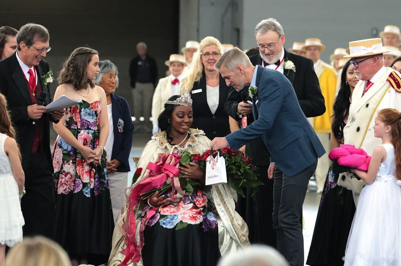 COURTESY PHOTO: DAVID ASHTON - Portland Mayor Ted Wheeler gave Mya, the queen of Rosaria, a gift after her coronation.