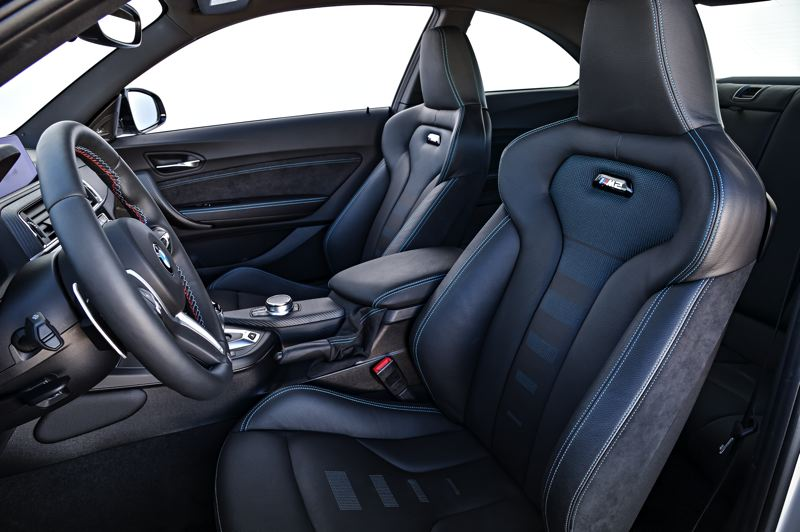COURTESY BMW GROUP - The deeply contoured from bucket seats in the 2019 BMW M2 Competition Coupe hold the driver and passenger firmly in place during high speed driving.