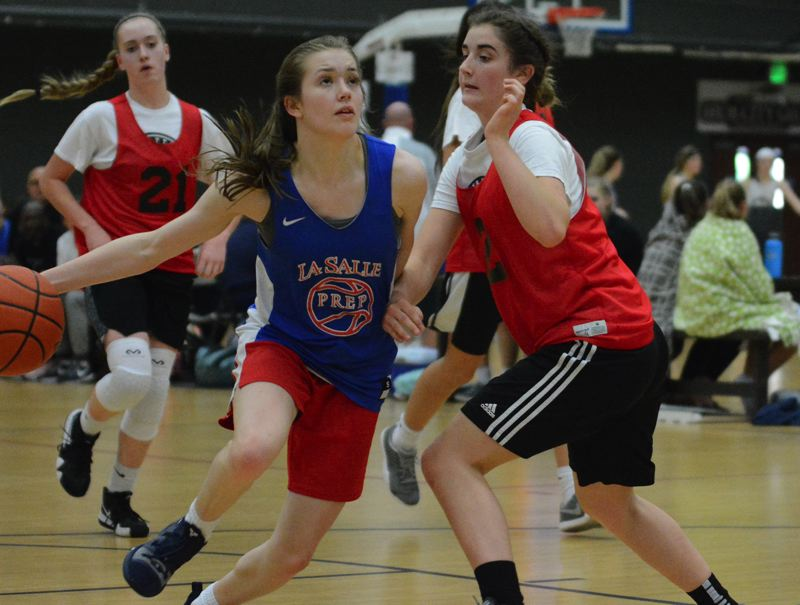 PMG PHOTO: DAVID BALL - La Salle Preps Emma Buchanan drives to the basket during the Falcons 52-35 win over Mossyrock in the JV bracket title game Sunday in Centralia.
