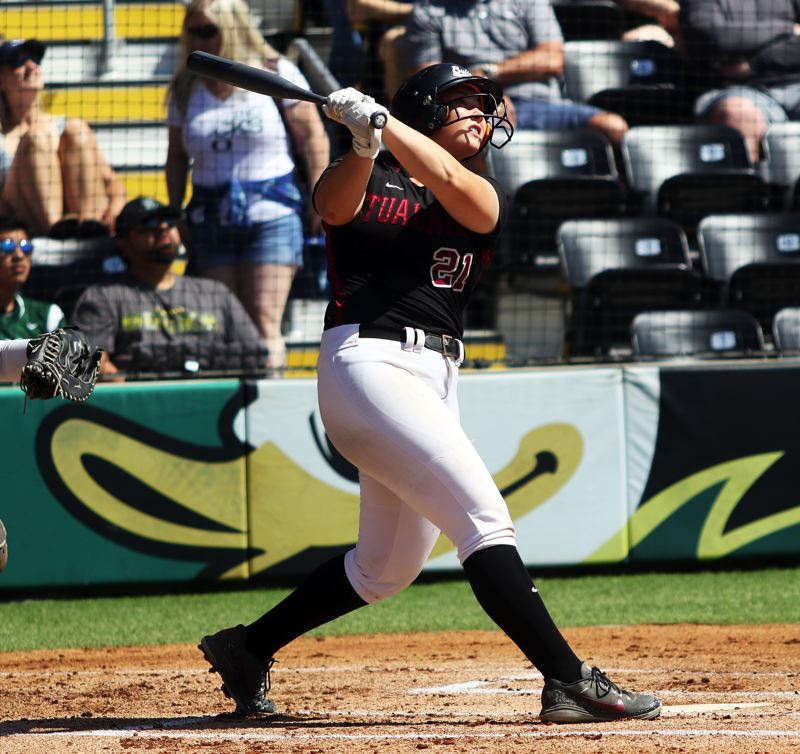 PMG PHOTO: DAN BROOD - Tualatin High School senior Emily Johansen, here hitting a home run in the Class 6A state championship game, was named the Three Rivers League Player of the Year.