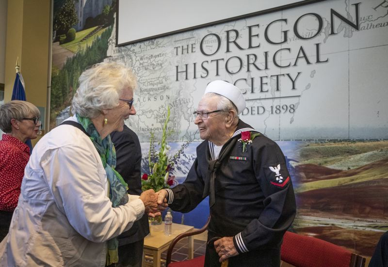PMG PHOTO: JONATHAN HOUSE - WWII veteran Ben Asquith chats with Marie Wachlin during OHS's Celebration With Heroes event.