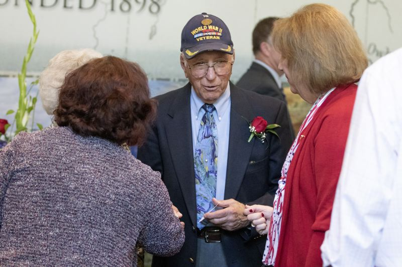 PMG PHOTO: JONATHAN HOUSE - Abe Laurenzo chats with supporters after giving his first-hand impressions of D-Day during the Celebration of Heroes event.
