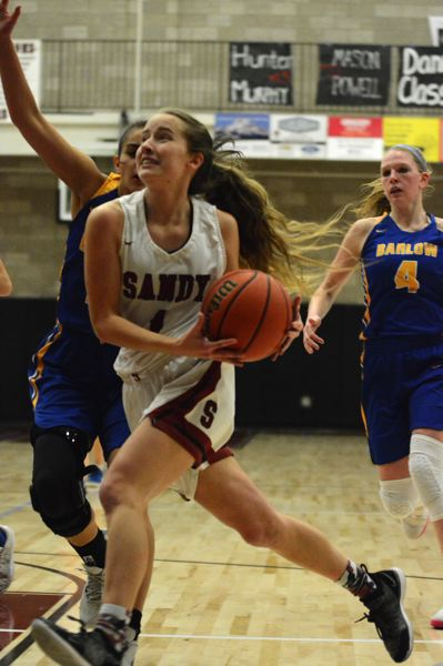 PMG PHOTO: DAVID BALL - Bella Kansala attacks the hoop during a home game against rival Barlow.