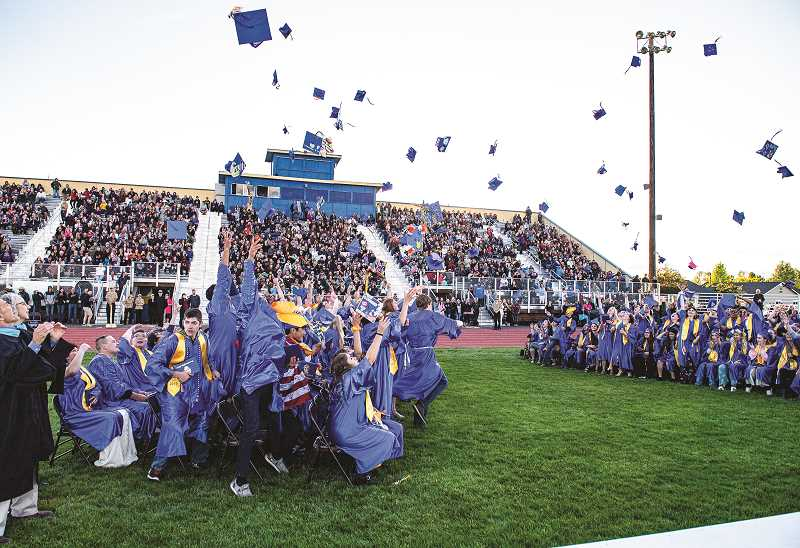LON AUSTIN/CENTRAL OREGONIAN  - The Crook County High School Class of 2019 students jubilantly hurl their caps into the air at the conclusion of their graduation ceremony at Ward Rhoden Stadium Friday evening.