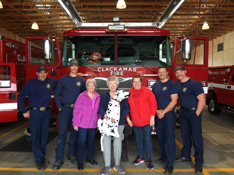 COURTESY PHOTO - With the Hilltop Fire Station's mascot Spot are (from left) Clackamas Fire Capt. Mark Corless; firefighter Dylan Herbert; Joan Schultze; Angela Wright and Amy Willhite of the Gaffney Lane Neighborhood Association; apparatus operator Shawn Lahodny; and firefighter Mike Hess.