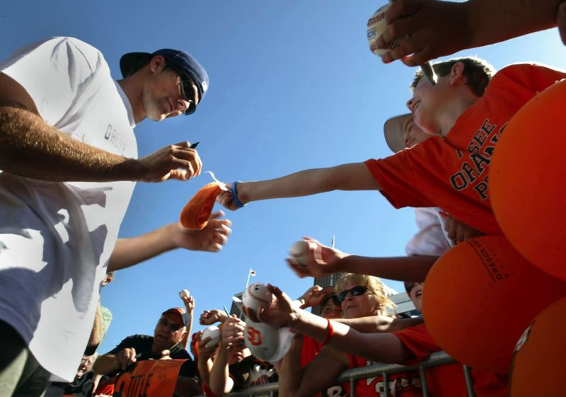 PMG FILE PHOTO: L.E. BASKOW - Mitch Canham (left) signs autographs after helping lead Oregon State to its second national championship in baseball in 2007.