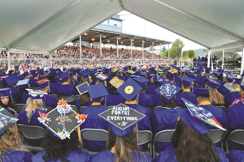 GRAPHIC PHOTO: GARY ALLEN - Newberg High School seniors participating in a commencement ceremony Friday evening adorned their mortar boards with a variety of art and messages.