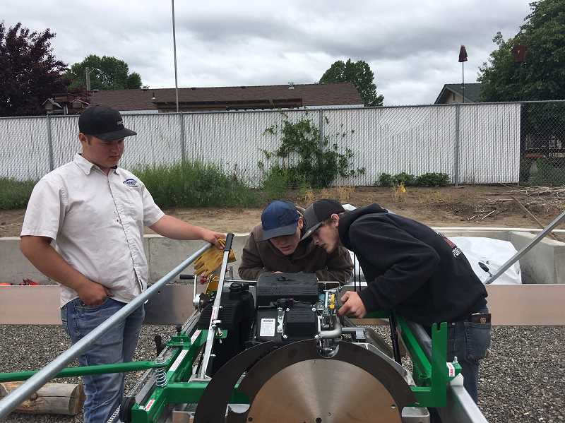 PHOTO COURTESY OF CROOK COUNTY SCHOOL DISTRICT - Crook County High School students learn to use the new Lucas Radial Sawmill.