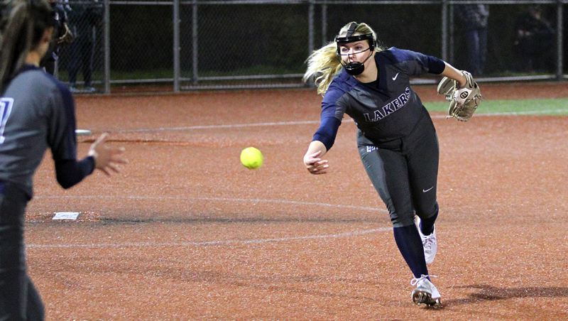 PMG PHOTO: MILES VANCE - Lake Oswego senior Marin Penney was named first-team all-Three Rivers League after excelling with her bat, her glove and as a pitcher in 2019.