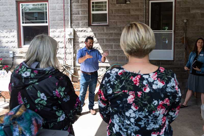 PMG PHOTO: CHRISTOPHER OERTELL - Kemp Shuey, from Community Action, introduces members of the Home Builders Association to the recently remodeled Hillsboro Family Shelter on Friday, June 7. Individual families can stay at the Hillsboro Family Shelter for up to six weeks while they receive assistance from Community Action staff.