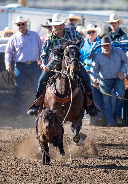 LON AUSTIN - Bubba Lutrell of Prineville and Culver High School, shows his skills in the tie down roping event. He will participate in the State Finals Rodeo  in  Prineville July 11-20, at the Crook County Fairgrounds.