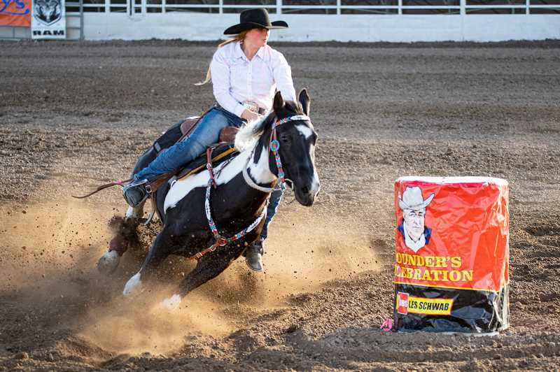 LON AUSTIN - Jaiden Unruh, of Madras, shows off her skill in the barrel racing competion.