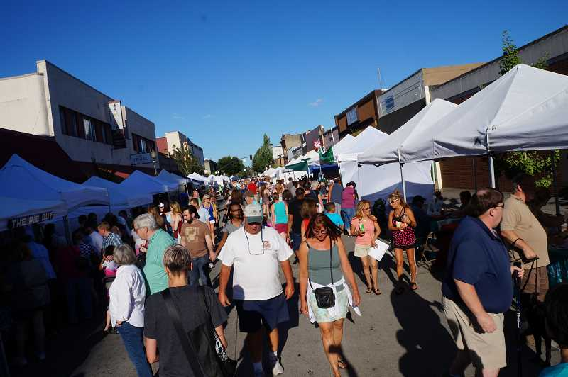 FILE PHOTO - Downtown Hillsboro's annual summertime tradition, Tuesday Night Market, returns this week. The market runs through August.