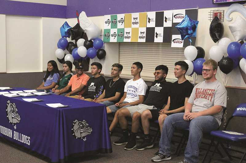 PMG PHOTO: PHIL HAWKINS - From left, Miriam Barbosa, Nathalie Rios, Jairo Aguirre, Jose Ochoa, Salvador Perez, Edwin Silva, Jesus Rodriguez, Pedro Hernandez and Jacob Hesse committed to compete athletically in college last week.