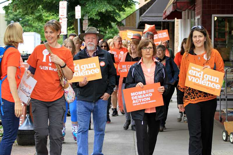 COURTESY PHOTO: ANNEMARIE JACQUES - State Sen. Chuck Riley, Congresswoman Suzanne Bonamici and state Rep. Courtney Neron lead a march through downtown Hillsboro, calling for new gun legislation to end mass killings.