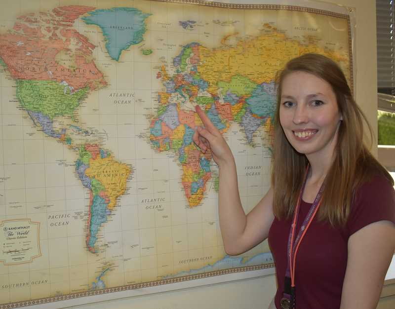 PMG PHOTO: EMILY LINDSTRAND - Estacada Middle School teacher Christine Boatman points to Greece on her classroom map. Boatman will travel to Greece this summer on a fellowship from the Center for Geography Education in Oregon.