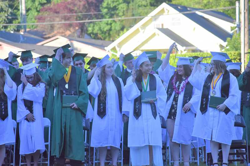 PMG PHOTO: EMILY LINDSTRAND - Members of Estacada High Schools class of 2019 turn their tassels at the end of their graduation ceremony on Saturday, June 8.