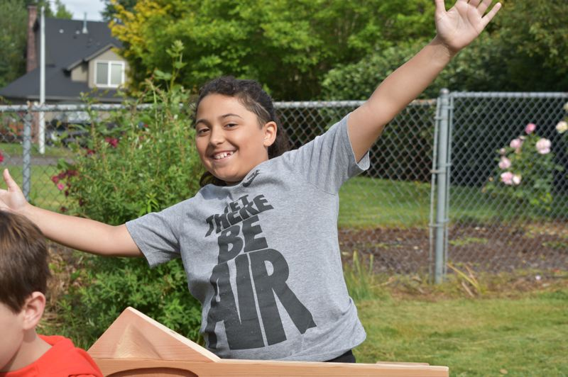 PMG PHOTO: TERESA CARSON - Kayne Diaz is proud of the bench he and Avery created.