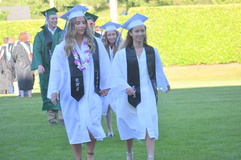 PMG PHOTO: EMILY LINDSTRAND - Students in Estacada High Schools class of 2019 are excited to enter Buzz Randall Field for their graduation ceremony.