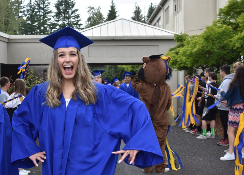 PMG PHOTO: TERESA CARSON - A Barlow senior just finished her grad walk through West Orient Middle School on Thursday, June 6.
