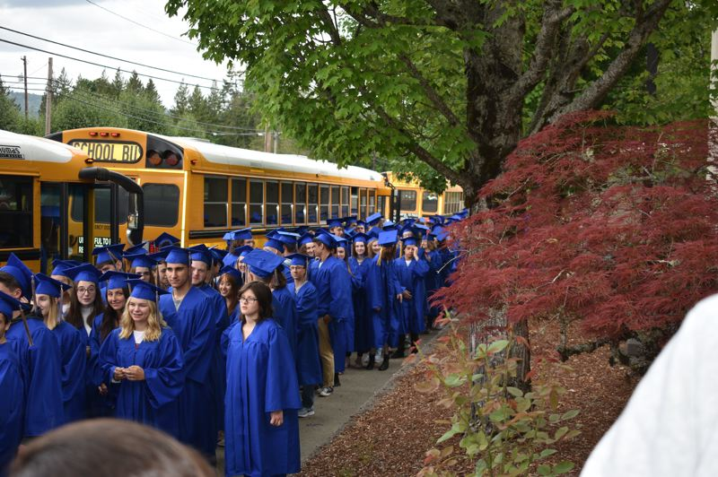 PMG PHOTO: TERESA CARSON - Barlow seniors line up in front of West Orient Middle School in anticipation of their victory grad walk.