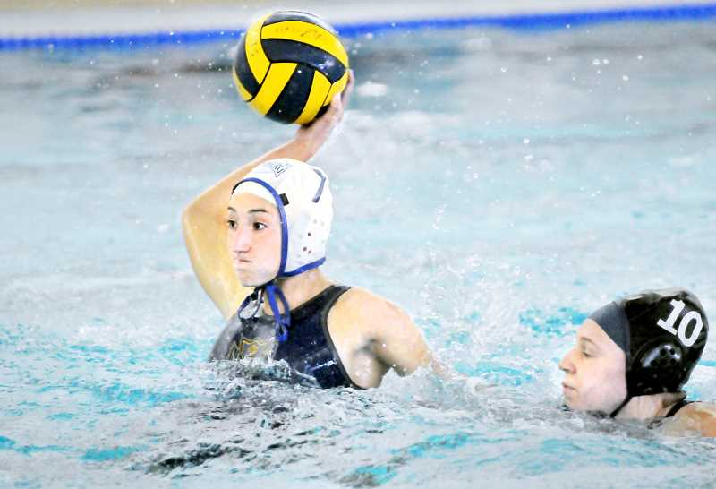 GRAPHIC PHOTO: GARY ALLEN - Mackenzie Russell is playing her final season of club water polo this spring after having recently graduated from Newberg High School.