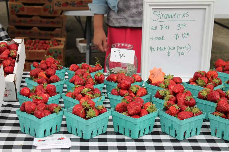 Several of the markets vendors offer strawberries.