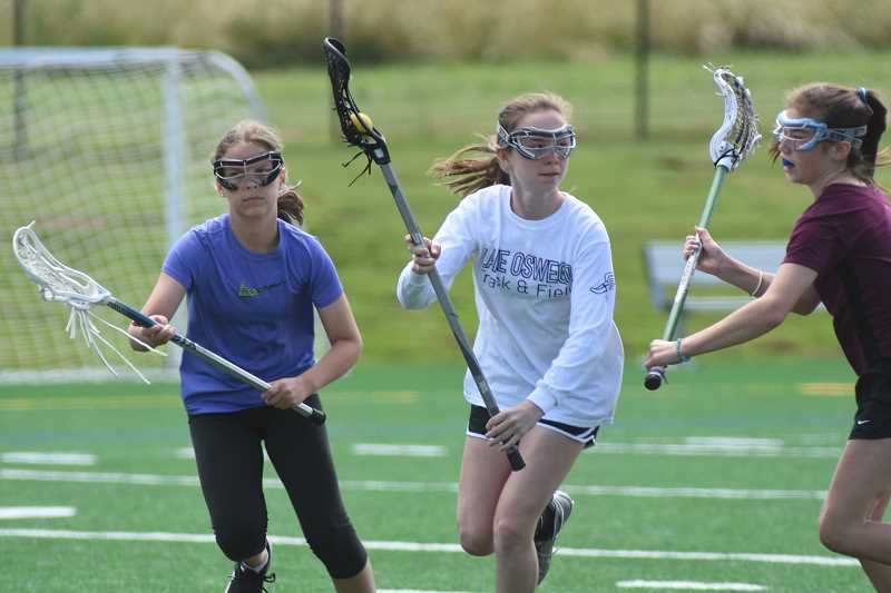 COURTESY PHOTO  - Girls ages eight to 14 can sign up for lacrosse camps through Lake Oswego Parks and Recreation.