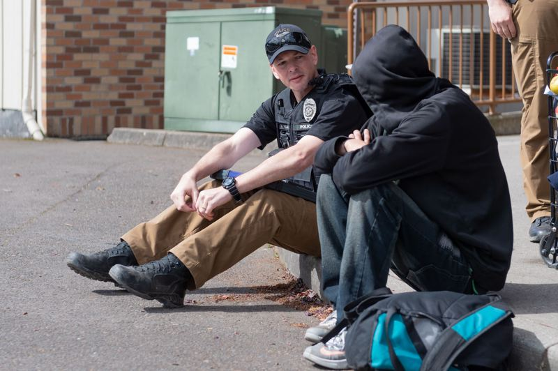 PMG FILE PHOTO - Mike Abshier, homeless liason officer with the Hillsboro Police, speaks to a homeless youth on the streets.