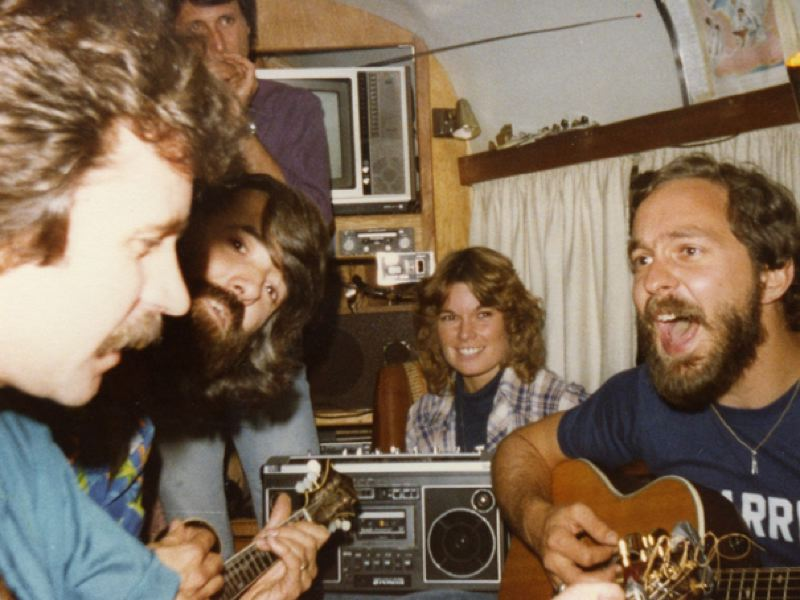 COURTESY PHOTO: WARREN FLOYD - Floyd, far right, is captured jamming on a tour bus in 1980 in Ft. Lauderdale, Fla., with Nitty Gritty Dirt Band members, from left, Jeff Hanna, Jimmie Fadden, John McEuen, and crew member  Tammy Collins.