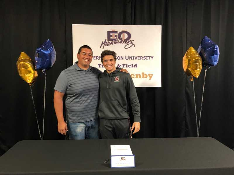 COURTESY PHOTO - Glencoe's Justin Lazenby poses for a photo with Tide head track and field coach Ian Reynoso during a ceremony at Glencoe High School. Lazenby will be attending and competing in track and field at Eastern Oregon University this fall.